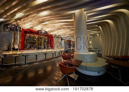 MOSCOW, RUSSIA - APR 25, 2017: Interior of MC Traders Lounge Bar in hall of Novotel Moscow City Hotel. Bar has fireplace and beer cellar.