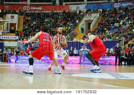 MOSCOW - APR 7, 2017: Players with ball at basketball game Euroleague CSKA Moscow (Russia) - Olympiakos (Greece) in Megasport stadium