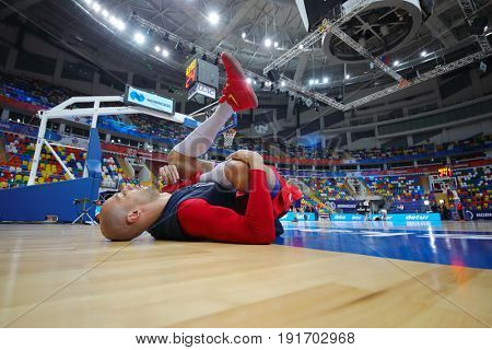 MOSCOW - APR 7, 2017: Man is doing stretching before game at basketball game Euroleague CSKA Moscow (Russia) - Olympiakos (Greece) in Megasport stadium