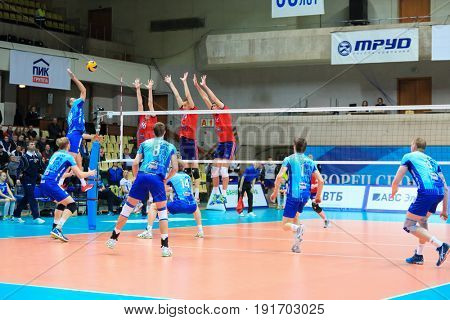 MOSCOW - APR 8, 2017: Triple block during game of Russian Volleyball Championship Dynamo (Moscow) - Nova (Novokuibyshevsk) in Palace of Sports Dynamo