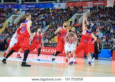 MOSCOW - APR 7, 2017: Fight for ball at basketball game Euroleague CSKA Moscow (Russia) - Olympiakos (Greece) in Megasport stadium