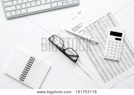 accounting work space with calculator, profit and tables on white desk background top view mock-up