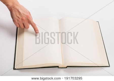 Blank white pages in an open hardcover book.