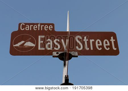 Easy Street Sign against a Blue Sky in Carefree, Arizona, USA