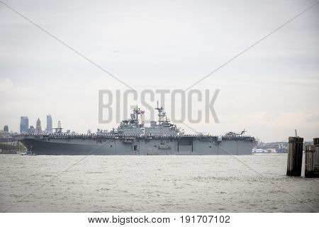 USS Kearsarge (LHD 3) passes Brooklyn on the Hudson River during the Parade of Ships marking the start of Fleet Week New York, JERSEY CITY NJ MAY 24 2017.