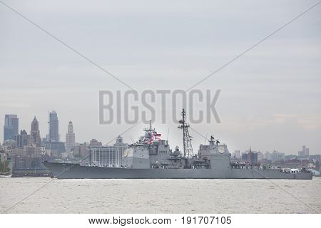 USS San Jacinto (CG 56) passes Brooklyn on the Hudson River during the Parade of Ships marking the start of Fleet Week New York, JERSEY CITY NJ MAY 24 2017.