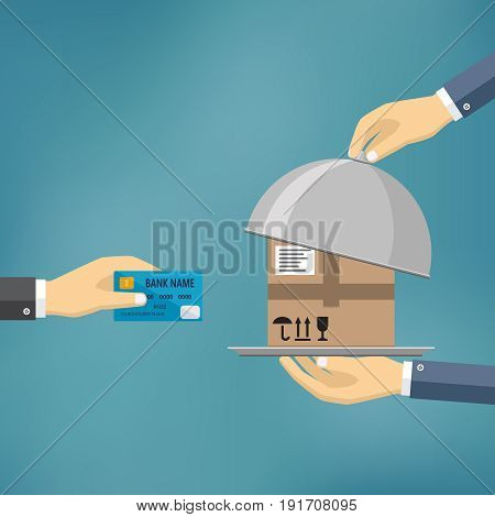 Hand with credit card and hands with parcel on the cloche.