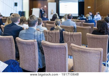 Business Meetings Concepts. People at the Law Conference Listening to The Host in Front of The Big Screen.Horizontal Image