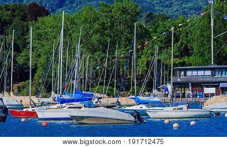 Zurich, Switzerland - 18 June, 2017: boats on Lake Zurich in the city of Zurich. Lake Zurich is a lake in Switzerland, extending southeast of the city of Zurich, which is the largest city in Switzerland.
