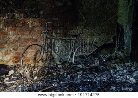 Burnt-out remains of the bicycle in the burnt house