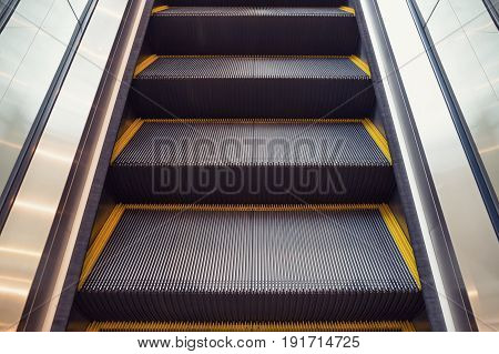 Escalator and step inside building for go to upstair.
