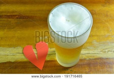 broken heart and glass of beer to forget