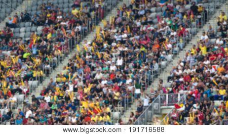 blurred crowd of people at stadium