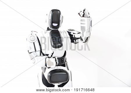 Look, I am strong. Robot is standing straight and showing okay sign. He rising fist. Isolated and copy space