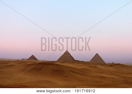 Great Pyramids On The Giza Plateau At Dusk