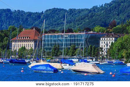 Zurich, Switzerland - 18 June, 2017: boats on Lake Zurich, buildings of the city of Zurich in the background. Lake Zurich is a lake in Switzerland, extending southeast of the city of Zurich, which is the largest city in Switzerland.