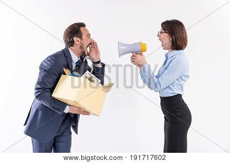 Who is louder. Quarrel between angry fired man with box and screaming woman with megaphone. Isolated background