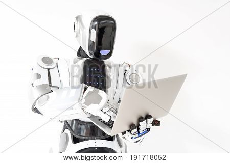 Futuristic worker. Concentrated android is working with laptop and looking at screen thoughtfully. Isolated background