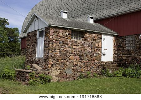 A vintage fieldstone milk house on a small dairy farm.