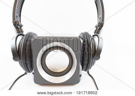 Speaker with headphones stalls on a white background.