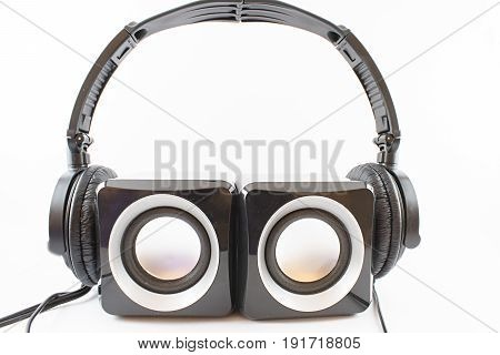Speakers with headphones stalls on a white background.