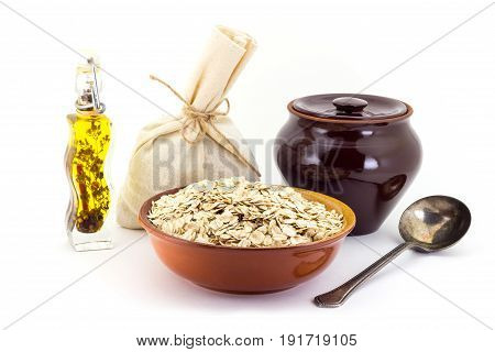 The Composition Of The Oatsmeal Groats In A Clay Pial Next To A Clay Pot And A Copper Spoon,
