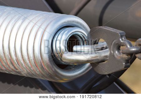 Steel Spring On Industrial Or Agricultural Machinery, Technology And Engineering Concept