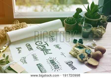 Painting paper words icons design cactus plants on a wooden table