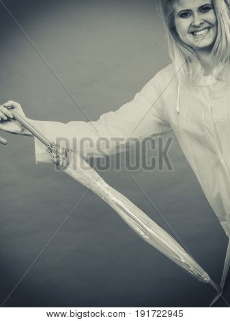 Happy Woman Wearing Raincoat Holding Closed Umbrella