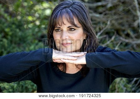 Middle Aged Woman Smiling While Looking Off To The Side