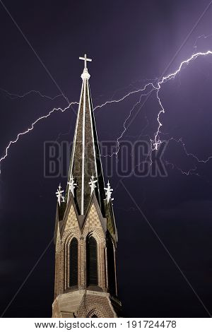 Church Steeple in front of Dramatic Lightning Bolt