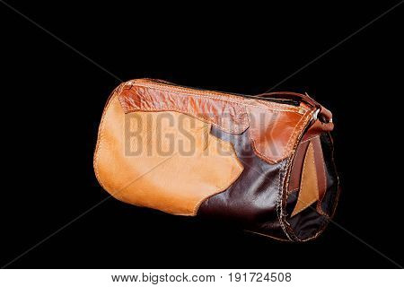 Fashion leather bag on a black background.