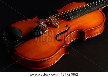 Violin Close-Up Isolated on a Black Background