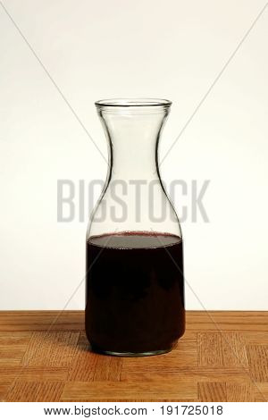 Wine Carafe on Oak Table and White Background