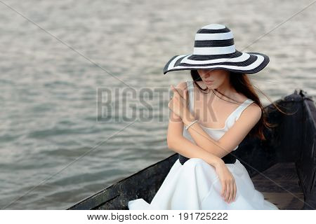 Mysterious  Woman in White Dress Sitting in an Old Boat