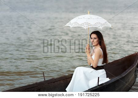 Happy Woman with Lace Parasol in an Old Wooden Boat