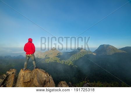 Man On Top Of Mountain Sitting On The Rock Watching A View Landscape At Doi Luang Chiang Dao, Chiang