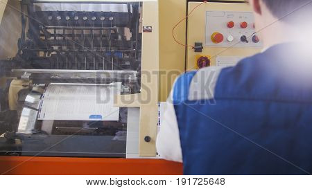 Working printing machine, polygraph industry, close up