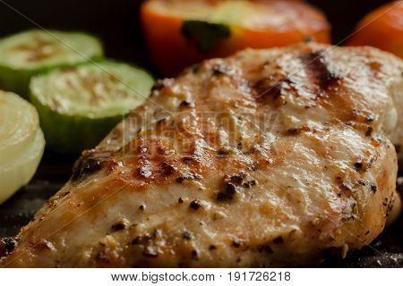 Grilled chicken breast on pan for barbecue with many vegetable. Close up concept of chicken breast barbecue for background. Roasted chicken breast for lunch or dinner. Delicious homemade barbecue. Grill chicken breast or pork steak on pan.