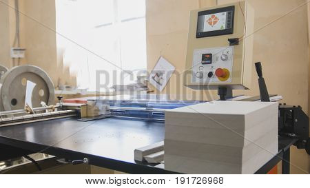 Machine working in printing house, polygraph industry - cleaning equipment, close up