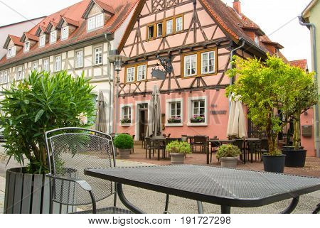 Walldorf, Germany - June 4, 2017: A Metal Table And A Chair At A Cafe At The Square Of Historic Old