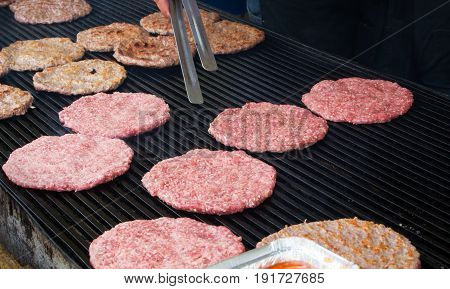 Burger Patties Preparation On Barbecue Grill At The Croatian Street Market, Frankfurt Am Main, Germa