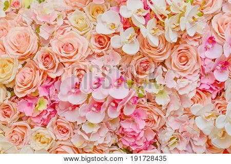 fake flowers of beautiful pink roses and orchids for wedding decoration or background of your work