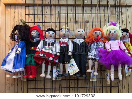 Prague - September 24 2016: Traditional czech handmade wooden puppets for sale at Havel's market.