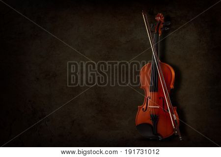 Instrument for violin and orchestra on a dark background. Place for inscription.