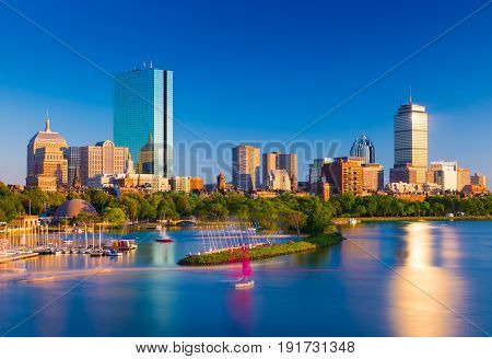 Boston skyline at the evening. Cityscape of Back Bay Boston. Skyscrapers and office buildings reflected in the water of Charles River.