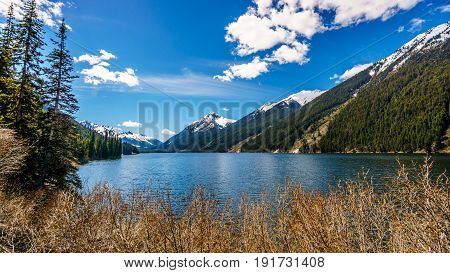 Duffey Lake in the Coast Mountain Range between Pemberton and Lillooet in southern British Columbia. The snow capped peak of Mount Rohr at the far south end of the lake