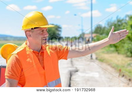 Young Construction Worker Signalling With His Hand
