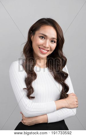 Portrait of beautiful asian woman with arms crossed