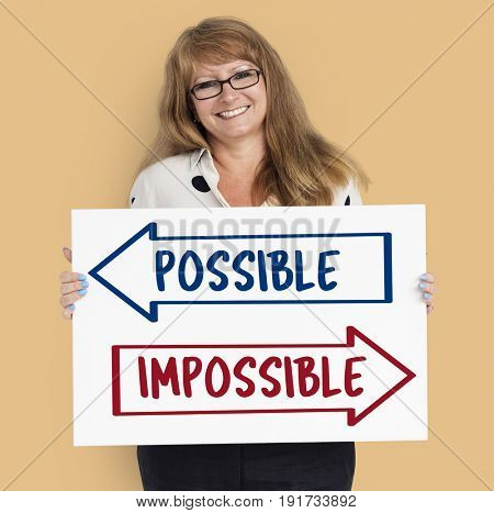 Caucasian woman holding banner with words